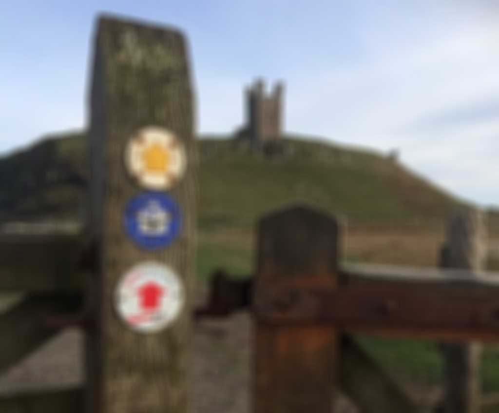 3-2-1_way_marker_at_Dunstanburgh_Castle.JPG blurred out