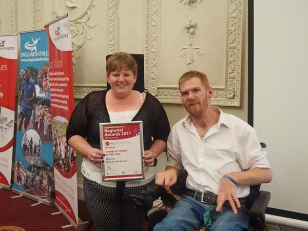 Wednesday winner- Christine with guest speake rPara Athlete Stephen Miller.jpg