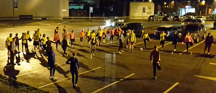 running group warm up in car park