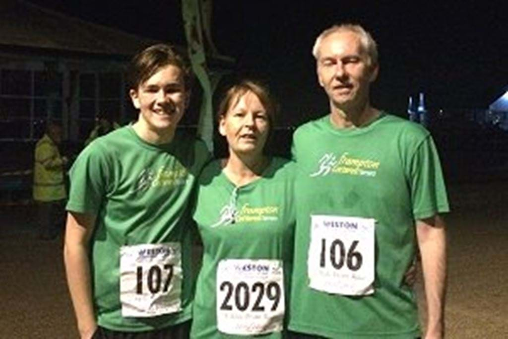 Cathie_Walsh_son_and_hubbie_in_club_shirts_after_our_5mile_Weston_Prom_Run300.jpg